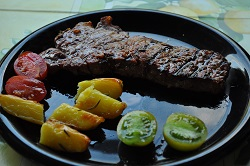 Grilled beef steak with baked potatoes