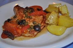 Schweinekoteletts mit Oliven