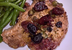 Grilled pork chops with olives