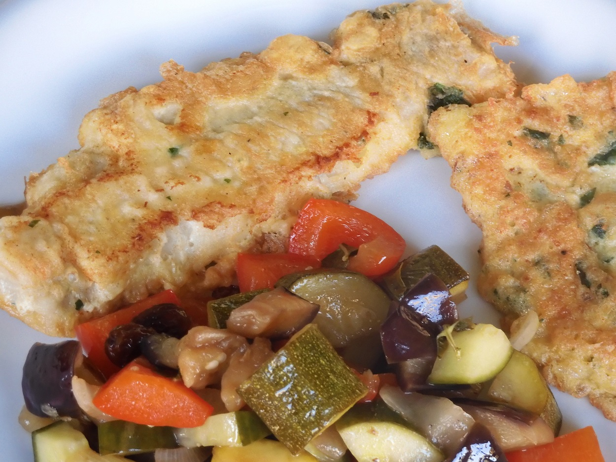 Piccata of cod fillets with sweet and sour vegetables