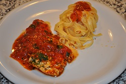 Strips of chicken with tomato sauce
