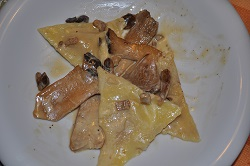 ravioli with buffalo mozzarella with cardoncelli ragù
