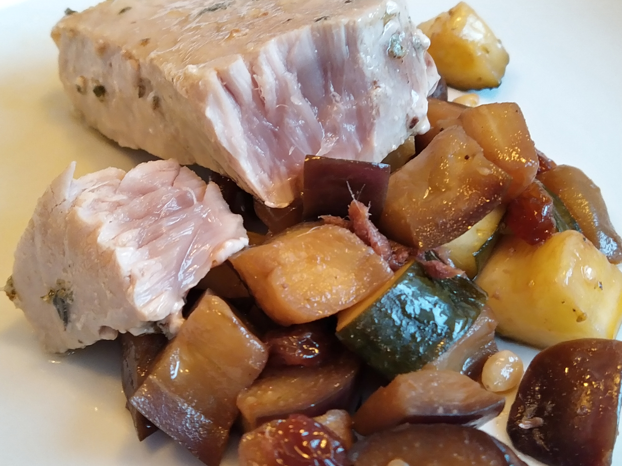 Tuna fillets in a pan with sweet and sour vegetables