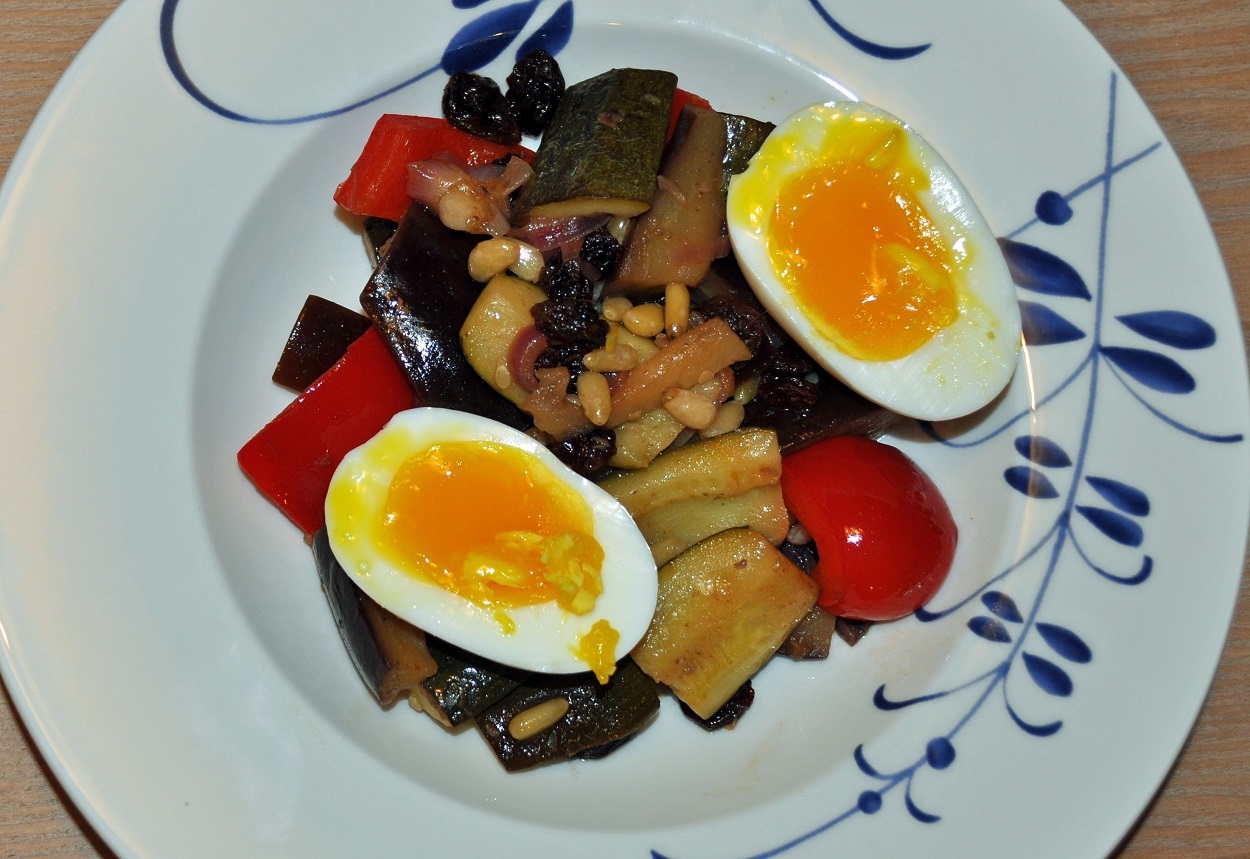 Sautéed vegetables in sweet and sour sauce with barzotte eggs